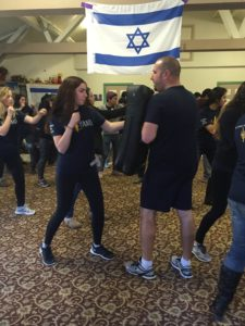 West Coast Executive Director and Bay Area Campus Coordinator David Kadosh leads a Krav Maga workshop for students in California.