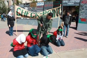 Anti-Israel activists at UCLA set up a mock checkpoint and spread baseless lies about the IDF (photo credit: AMCHA Initiative).