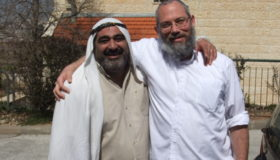 """An Israeli and Palestinian-Arab man in a """"settlement"""" in Judea/Samaria. """"Settlements"""" throughout Judea and Samaria employ thousands of Palestinian-Arabs and pay them roughly 3-4 times what they would make working in the Palestinian Authority (photo credit: Yaacov, Wikipedia Commons)."""